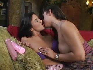 Latina hottie using a dildo on the sofa