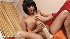 Romana has fun riding a big white brutal dildo