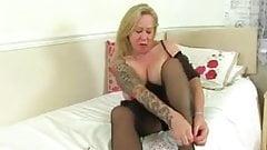 English milf Camilla strips