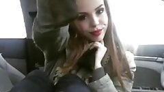Cutie smells her socks in her car