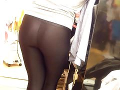Teen store attendant in shiny spandex