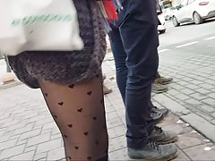 Sexy slut in black patterned fishnet and mini skirt Thumbnail