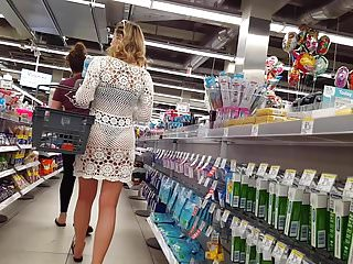 Candid voyeur girl in bikini with see thru wrap shopping