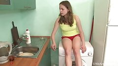 hairy milf masturbating on a washing machine