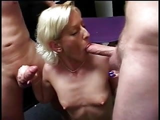 Horny blond bitch sucks cocks then gets face jizz covered