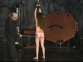 Strapped up slave gets her ass cheeks whipped by master