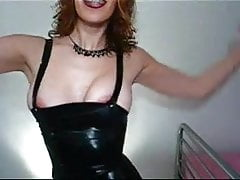 Redhead with braces in a latex dress 1