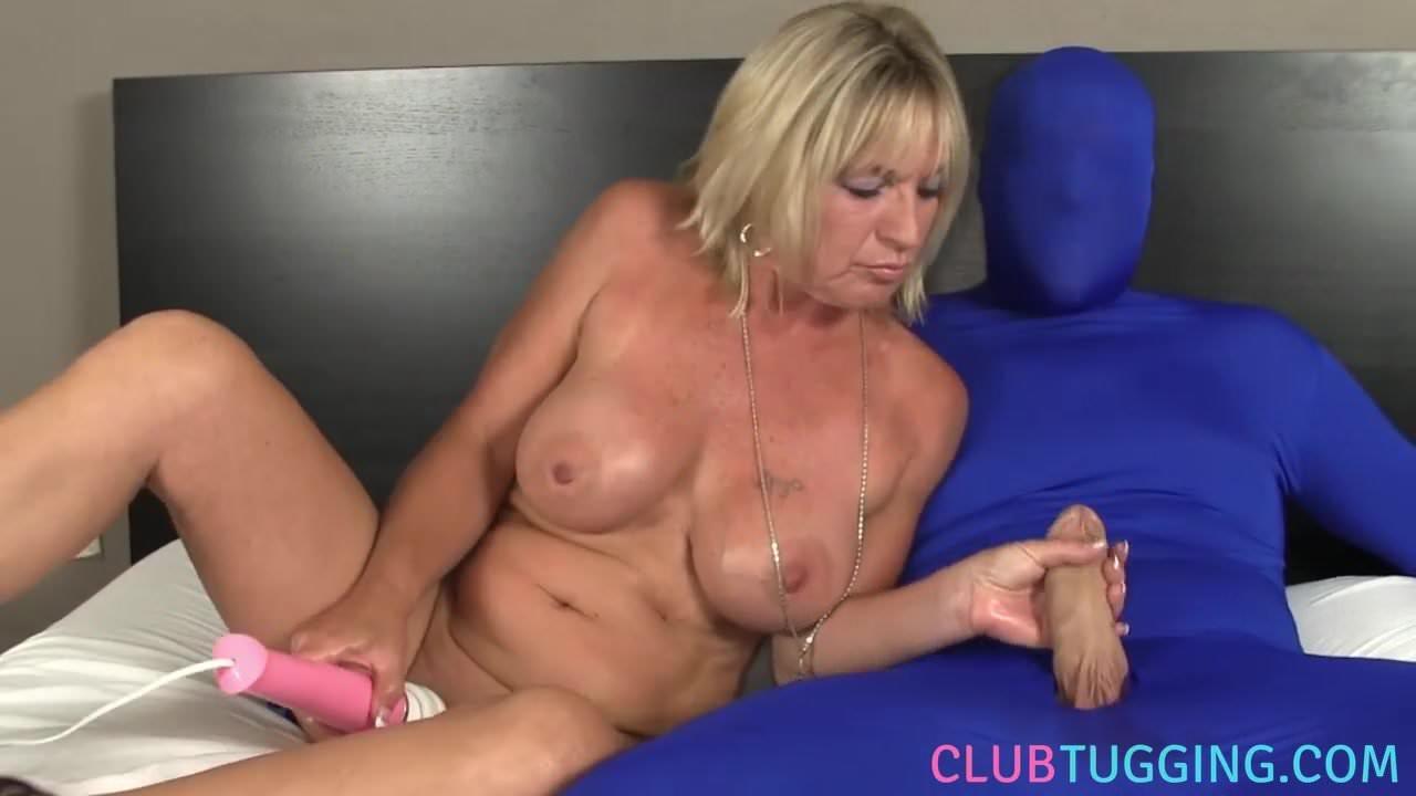 Bigtitted milf tugging gimps throbbing cock