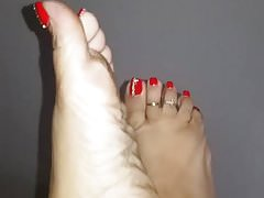 Sexy red pedi on pretty feet