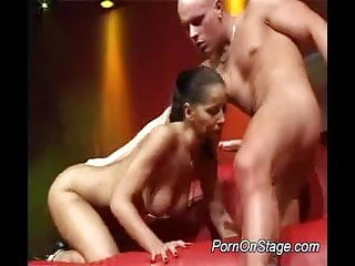 Nasty babe does porn on stage taking hard cock in mouth