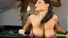 Big tits on bellyard table