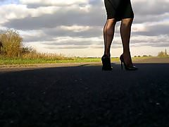 Walking in black patent hells fishnets and black tight skirt