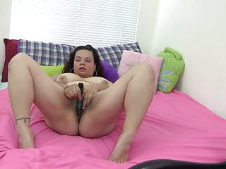 Curvy young slut loves shoving a fuck toy in her slit