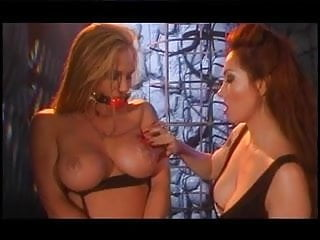 2 sexy bitches playing around with gags and candle wax