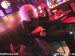 Petite housewife masturbates and cums in public bar.