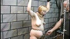Slave gets bound with leather cuffs and dom gives her electric shocks in nipples