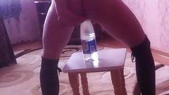 Slave girl riding bottle
