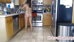 Girl naked cleans the house