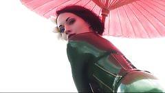 Beautiful girl modelling green catsuit