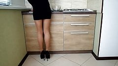 Heels, tights and mini skirt (cooking to eat in the kitchen)