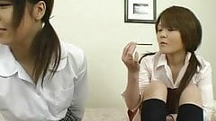 Japanese women caress each other