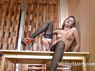 Fina fingers her hairy bush on the table
