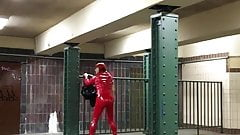 Cruising at trainstation in red pvc suit