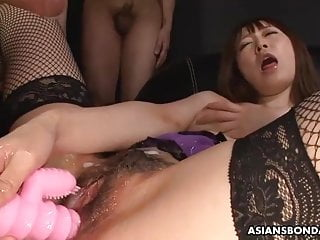 Obedient Asian lady oiled up before being toyed and fisted