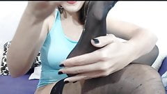 Camgirl spits on her nylon feet