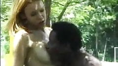 Young shemale is sucking a black cock