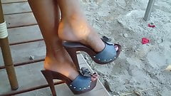 12 Dangling blue leather strapped wooden mules.