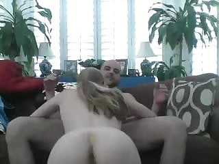 Wife sucks husband on couch before riding him