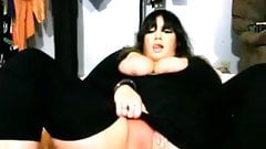 Chubby chick in black nylon plays with her pussy