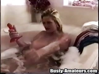 Sexy Heather fucks her pussy with a red dildo