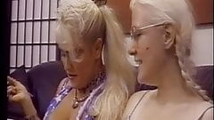 Blonde lesbians fuck each other with dildos