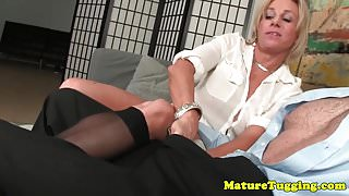 Busty cougar wanks cock till cum on stockings