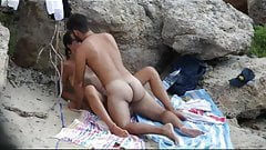Young couple caugth during sex on the beach