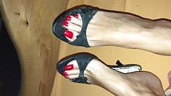 Black Mules and red Toenails