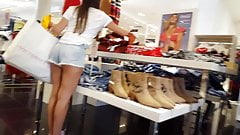 Candid voyeur teen hottie shopping short shorts