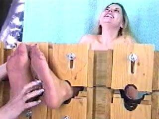 Ticklish nylon feet in stocks