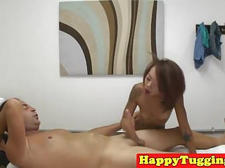 Petite asian masseuse jerking client for tip