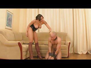 Strict Mistress holds her Slave