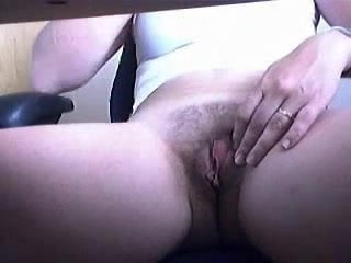 Hidden cam under desk caugh mummy fingering her pussy