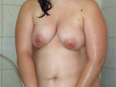 Horny wife masturbating in the shower