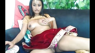 Beautiful Indian camslut fucking her creamy pussy