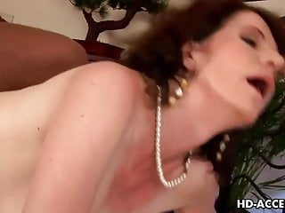 Wild cock gobbling brunette milf in action