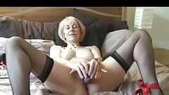 Blonde Milf on the Bed in Stockings