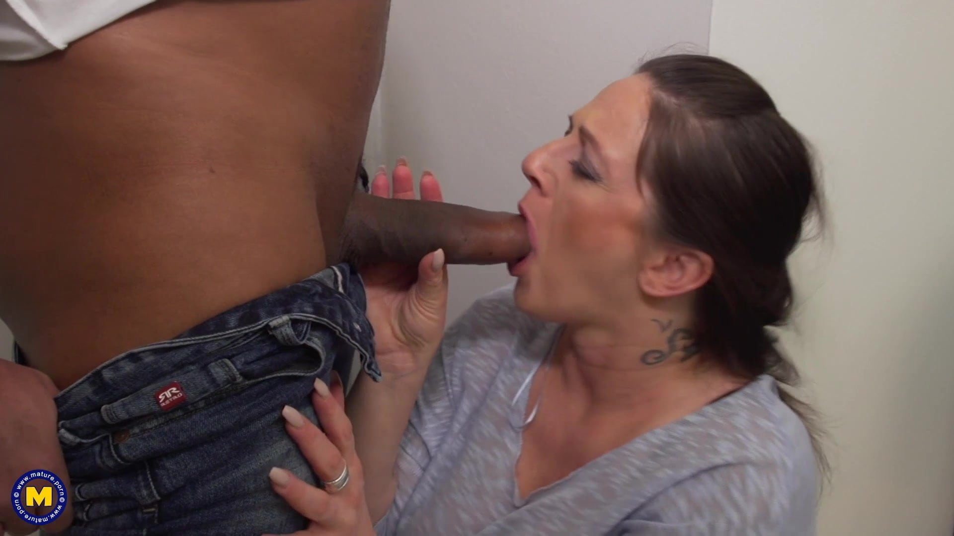 Sticking dildo down penis