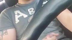 Jacks off behind the wheel