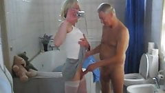 crosdresser having a blowjob by an old guy